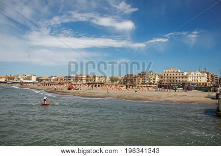 Ostia, Italy - May 18, 2013. Overview of the beach and town of Ostia between the Mediterranean sea and sunny sky The town is a seaside resort and ancient port of Rome. Lazio region