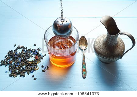 Glass Of Tea With Jug And Tea Leaves, Strainer Brew