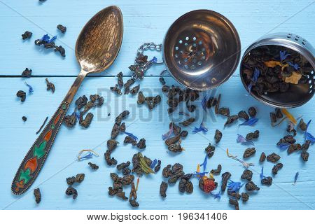 Small Decorative Teaspoon With Tea Leaves And Strainer