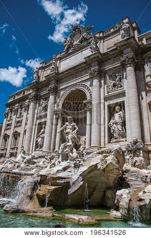 Overview of the world-famous Trevi Fountain in sunny day at the city center of Rome, the incredible city of the Ancient Era, known as