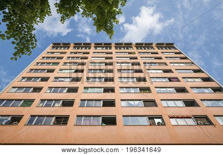 Social Housing Skyscraper In Berlin With Blue Sky
