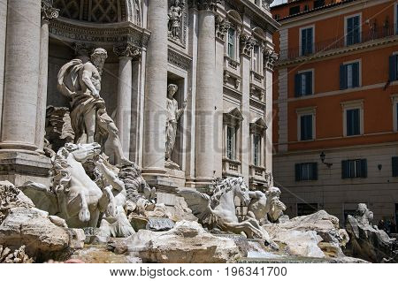Close-up of the world-famous Trevi Fountain in sunny day at the city center of Rome, the incredible city of the Ancient Era, known as