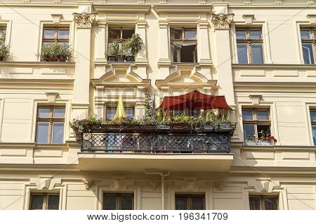 Old Berlin House With Balcony And Parasols In Summer