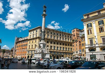 Roma, Italy - May 19, 2013. View of square, building and Column of the Immaculate Conception in Rome, the incredible city of the Ancient Era, known as