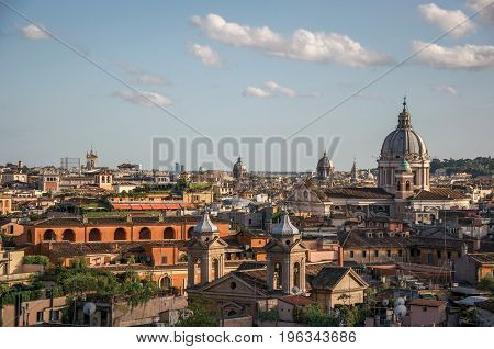 Overview cathedrals domes and roofs of buildings in the sunset of Rome, the incredible city of the Ancient Era, known as