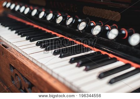 Keys of the ancient harmonium with a shallow depth of field
