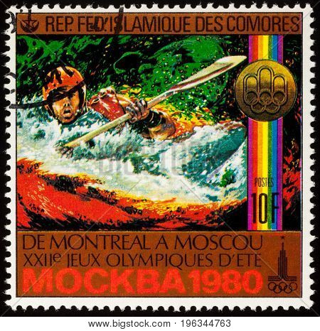 Moscow Russia - July 20 2017: A stamp printed in Comoros shows kayaking water slalom competition series