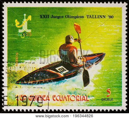 Moscow Russia - July 20 2017: A stamp printed in Equatorial Guinea shows kayaking competition series