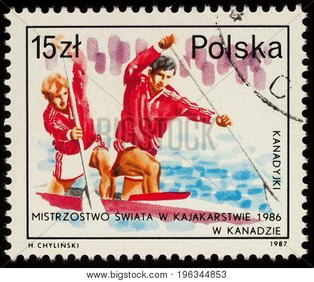 Moscow Russia - July 21 2017: A stamp printed in Poland shows canoeing competition devoted to the XX World Championship in canoeing and kayaking circa 1986