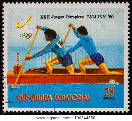 Moscow Russia - July 20 2017: A stamp printed in Equatorial Guinea shows canoeing competition series