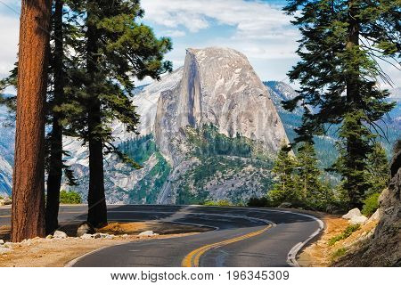 The road leading to Glacier Point in Yosemite National Park California USA with the Half Dome in the background.