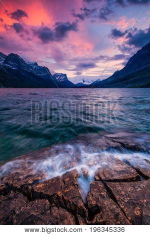 Sunset on the shore of St Mary Lake along the Going to the Sun Road in Glacier National Park Montana USA