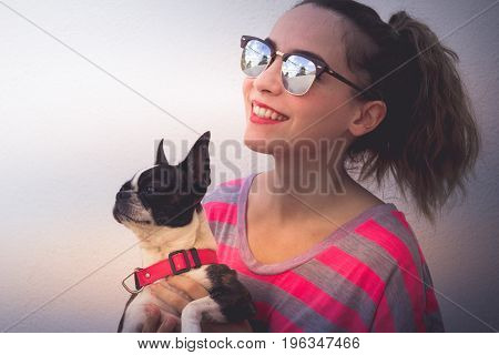 Young Modern Smiling Woman With Her Dog In A Casual Attitude