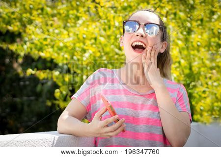 Young Modern Surprised Woman Using Her Cellphone