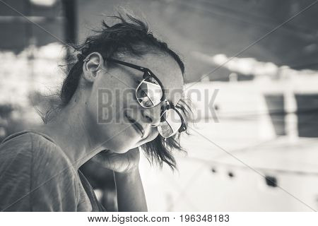 Young Modern Smiling Woman With Sunglasses And Casual Expression