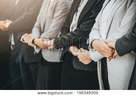 Businessman and woman stand in a row while holding hand.Business success and teamwork concept.