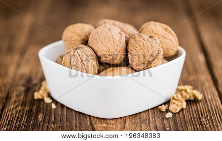 Whole Walnuts On Wooden Background (selective Focus)