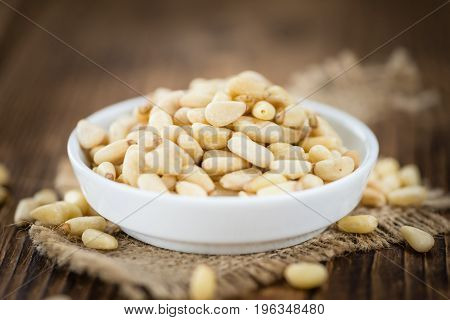 Wooden Table With Pine Nuts (selective Focus)