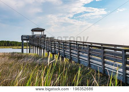 Wooden ramp over marshland and the observation point on the grounds of the Bodie Island lighthouse on the Outer Banks of North Carolina near Nags Head.