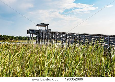 Wooden ramp over marshland leading to the observation point on the grounds of the Bodie Island lighthouse on the Outer Banks of North Carolina near Nags Head.