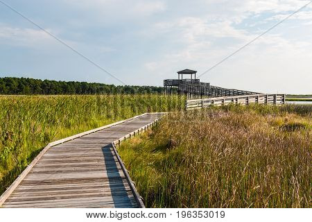 Boardwalk through marshland leading to the observation point on the grounds of the Bodie Island lighthouse on the Outer Banks of North Carolina near Nags Head.