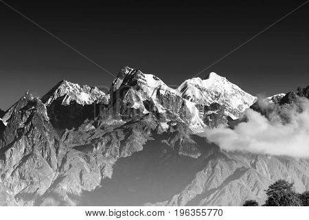 From left - Mount South Kabru (24215 feet) Mount North Kabru and Mount Talung (24200 feet) - beautiful view of great Himalayan mountains at Ravangla Sikkim. Black and white image.