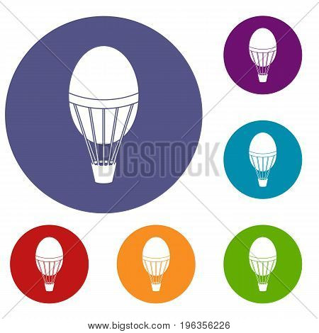 Hot air balloon icons set in flat circle red, blue and green color for web