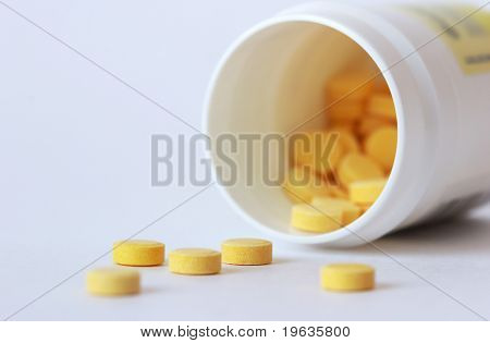 Yellow tablets on a white background