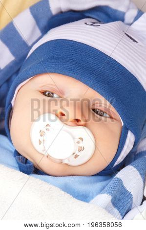 Newborn Baby Boy With Pacifier Or Teat