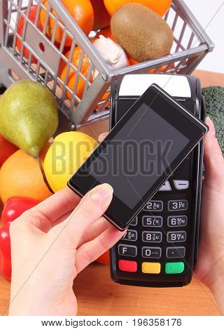 Using Payment Terminal And Mobile Phone With Nfc Technology, Cashless Paying For Shopping