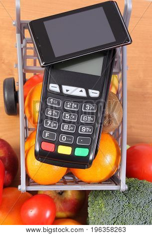 Credit Card Reader With Mobile Phone With Nfc Technology And Fruits And Vegetables
