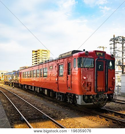 Toyama Japan - May 11 2017 : Orange passenger train of JR company with Ninja Hatori charactor at second bogey.