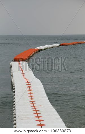 Sea buoys Safe Swimming zone separator vertical shot