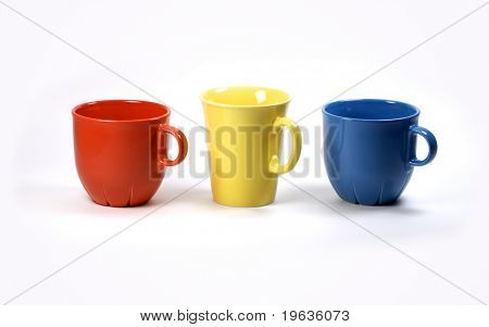 Isolated red, yellow and blue cups on white background (set of cups)