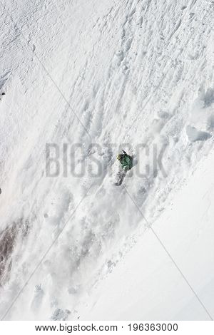Snowboard freeride. Freerider falling from a in avalanche