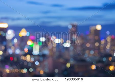 Twilight sky over city office blurred bokeh light abstract background