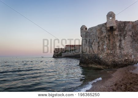The fortress of the old town of Budva in the evening