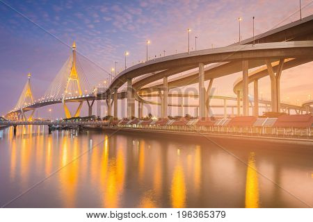 Beautiful twilight tone suspension bridge river front connect intersecrtion overpass highway