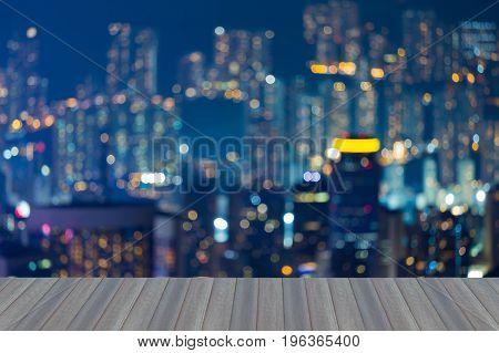Opening wooden floor Blurred bokeh light Hong Kong residence apartment night view abstract background