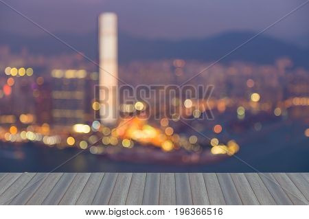 Opeing wooden floor Night blurred bokeh light Hong Kong city aerial view abstract background