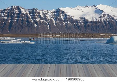 Opening wooden floor Winter season lagoon with mountain background Iceland natural landscape background