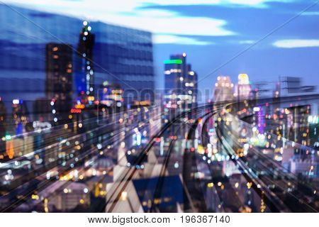 Train moving blurred motion double exposure with city light night view abstract background