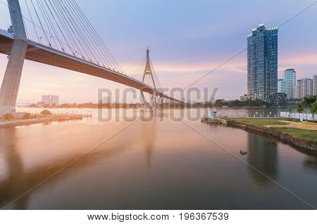 Rama9 Suspension bridge crossed Bangkok river with reflection view Thailand