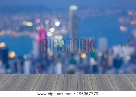 Opening wooden floor Hong Kong blurred bokeh aearial view central business downtown abstract background