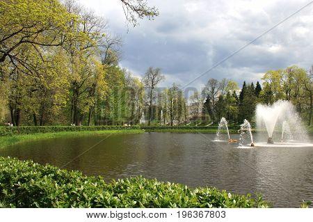 Peterhof, St. Petersburg - May 15, 2010: Park, pond and fountains in Peterhof, St. Petersburg