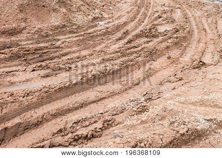 Dirty Broken Rural Road With Deep Tire Tracks.