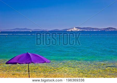 Adriatic Beach In Zadar With Megayacht Background