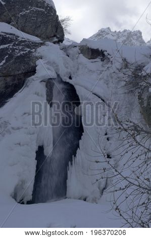 small waterfall in formazza valley during winter