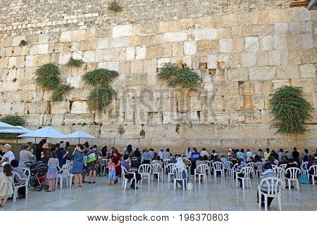 JERUSALEM, ISRAEL - June 15, 2017: religious jews, praying at the Wailing Wall ( Western Wall or Kotel ), womens sector, Old City of Jerusalem, Israel