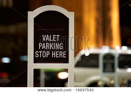 Closeup of Valet parking - stop here sign. Shallow focus depth